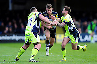 Ollie Devoto of Bath Rugby is double-tackled by Eifion Lewis-Roberts and Danny Cipriani of Sale Sharks. Aviva Premiership match, between Bath Rugby and Sale Sharks on April 23, 2016 at the Recreation Ground in Bath, England. Photo by: Patrick Khachfe / Onside Images