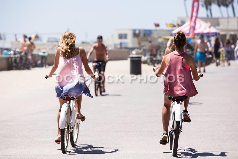 Girls Riding Beach Cruisers in Downtown Huntington Beach on the Boardwalk