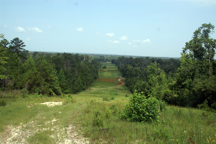 From the bluff above the Escambia River, the pipeline right of way stretches to the river.  The right of way has to be maintained as grass to allow visual inspections for leaks from planes.  This right of way is located in Escambia County, Florida.