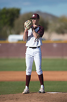 Mountain Ridge Mountain Lions starting pitcher Matthew Liberatore (32) looks to his catch for the sign during a game against the Boulder Creek Jaguars at Mountain Ridge High School on February 28, 2018 in Glendale, Arizona. Liberatore collected 14 strikeouts in his first appearance of the spring, leading the Mountain Lions to a 6-3 conference victory. (Zachary Lucy/Four Seam Images)