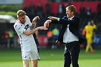 Oli McBurnie celebrates at full time with Graham Potter Manager of Swansea City during the Sky Bet Championship match between Swansea City and Rotherham United at the Liberty Stadium in Swansea, Wales, UK.  Friday 19 April 2019
