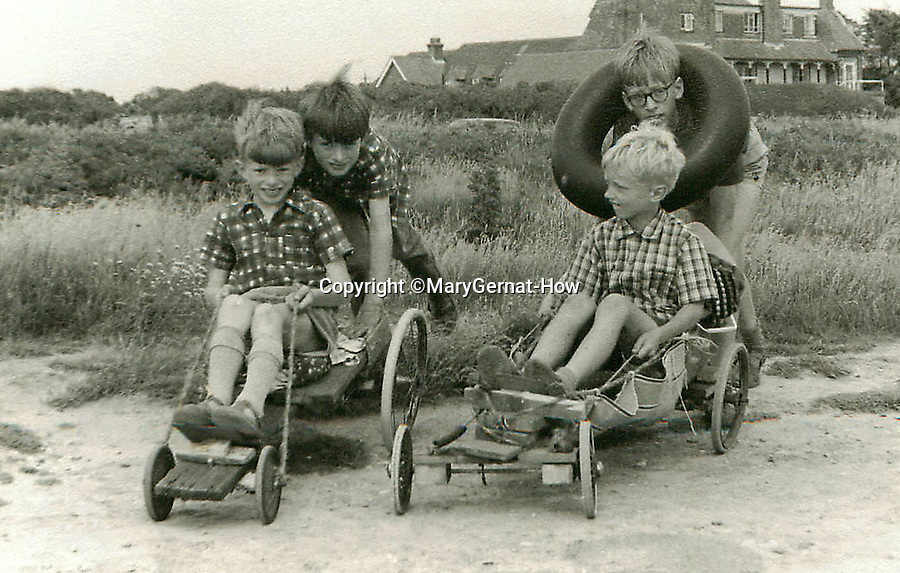BNPS.co.uk (01202 558833)<br /> Pic: MaryGernat-How/BNPS<br /> <br /> ***Single Use - Not For Archive***<br /> <br /> The boys at play near their seaside home in the mid 1960's.<br /> <br /> The real family behind Enid Blyton's iconic book covers has been revealed for the first time thanks to a hidden archive of sketches and family photos.<br /> <br /> Mary Gernat, who created the paperback covers for about 100 children's books in the 1960s, would get her young sons to stop mid-play and pose for her while she quickly sketched ideas for books like The Famous Five, the Secret Series, St Clare's and Malory Towers.<br /> <br /> Her son Roger How, 58, has now unveiled some of his mother's never-seen-before original sketches and finished book drafts which capture the classic images of childhood adventure he and his brothers helped create.