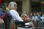 Gay handicapped woman in wheelchair participates in Gay Pride Parade