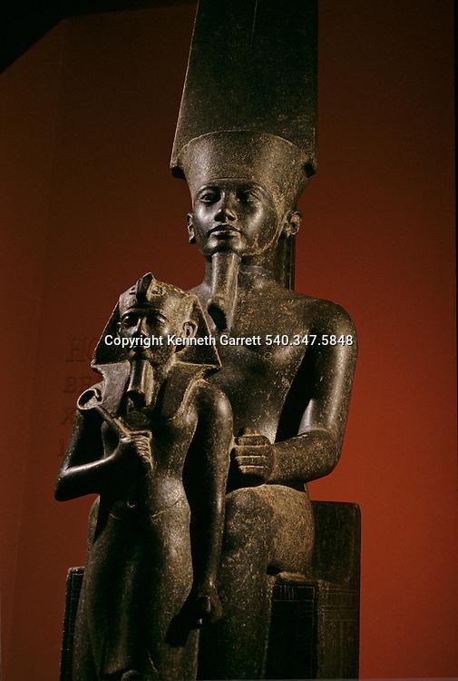 Statue of God Amun protecting Horemheb; Luxor; cachette,Tutankhamun and the Golden Age of the Pharaohs, Page 85