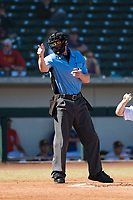 Home plate umpire Alex Tosi calls a strike during an Arizona Fall League game between the Salt River Rafters and the Mesa Solar Sox at Sloan Park on November 9, 2018 in Mesa, Arizona. Mesa defeated Salt River 5-4. (Zachary Lucy/Four Seam Images)
