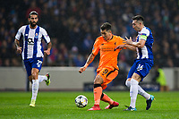Liverpool's Roberto Firmino holds off the challenge from FC Porto's Hector Herrera <br /> <br /> Photographer Craig Mercer/CameraSport<br /> <br /> UEFA Champions League Round of 16 First Leg - FC Porto v Liverpool - Wednesday 14th February 201 - Estadio do Dragao - Porto<br />  <br /> World Copyright &copy; 2018 CameraSport. All rights reserved. 43 Linden Ave. Countesthorpe. Leicester. England. LE8 5PG - Tel: +44 (0) 116 277 4147 - admin@camerasport.com - www.camerasport.com