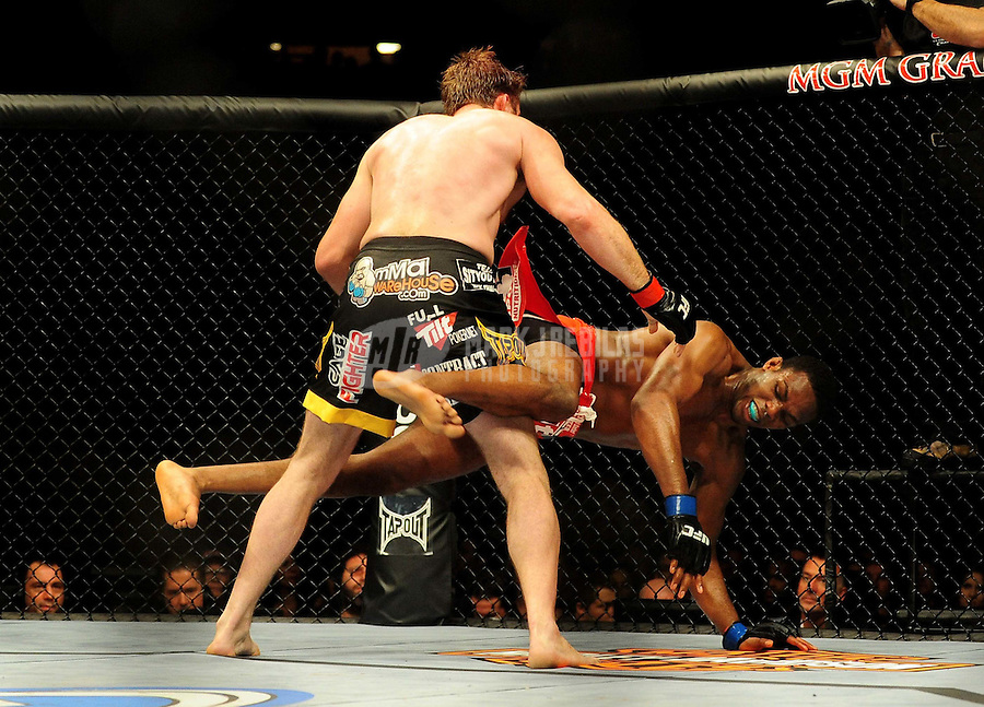 Jan. 31, 2009; Las Vegas, NV, USA; UFC fighter Jon Jones (red trunks) against Stephan Bonnar (black trunks) during the light heavyweight swing bout in UFC 94 at the MGM Grand Hotel and Casino. Mandatory Credit: Mark J. Rebilas-