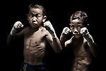 "10 years old Muay Thai Kickboxing figthers pose at Sangmorakot gymnasium in Bangkok, Thailand. Muay Thai, also know as ""Art of Eight Limbs"", is a hard martial art and Thailand's national sport. Photo by Victor Fraile --- Image by © Victor Fraile"