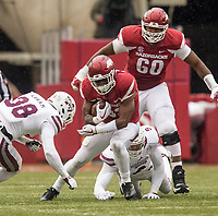 Hawgs Illustrated/BEN GOFF <br /> David Williams (33), Arkansas running back, evades Montez Sweat (9), Mississippi State linebacker, as Brian Wallace, Arkansas offensive lineman, blocks in the fourth quarter Saturday, Nov. 18, 2017, at Reynolds Razorback Stadium in Fayetteville.