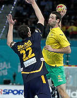 Spain's Angel Montoro Cabello (l) and Australia's Ognjen Matic during 23rd Men's Handball World Championship preliminary round match.January 15,2013. (ALTERPHOTOS/Acero) /NortePhoto