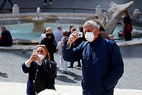 Tourists wearing masks<br /> Rome March 10th 2020. Rome the day after the last Minister Council's decree, that extends the restrictions from North of Italy to the entire country to contain Covid-19 Virus. All the shops (restaurants, pubs, and even supermarkets) will have to close at 6 pm. Gathering of people will be forbitten and people will have to maintain the 1 meter security distance. Citizens are furthermore invited to stay at home with the exception of people who have to go to work, to the pharmacy or to the supermarket.<br /> Photo Samantha Zucchi Insidefoto