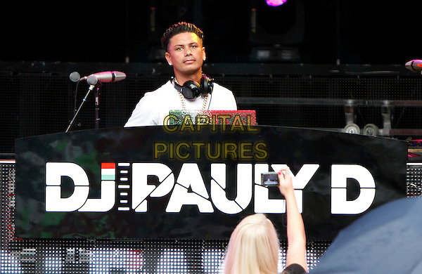 Jersey Shore's DJ Pauly D (Paul DelVecchio) performed in concert at the Chastain Park Amphitheatre on Thursday, August 22, 2013 in Atlanta, as part of the Backstreet Boys tour, Atlanta, GA., USA.<br /> August 22nd, 2013<br /> on stage in concert live gig performance performing music half length white t-shirt headphones spinning discs tattoos hand arm in air<br /> CAP/ADM/DH<br /> &copy;Dan Harr/AdMedia/Capital Pictures