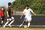 Palos Verdes, CA 02/09/12 - Michael Takeda (Peninsula #12) in action during the West vs Peninsula Bay League boys varsity soccer game.