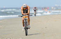 13 JUL 2013 - DEN HAAG, NED - Conrad Stoltz (RSA)  of South Africa races along the beach during the bike at the 2013 ITU Elite Men's Cross Triathlon World Championships in Kijkduin, Den Haag (The Hague), the Netherlands (PHOTO COPYRIGHT © 2013 NIGEL FARROW, ALL RIGHTS RESERVED)