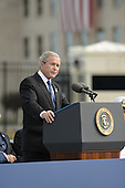 Arlington, VA - September 11, 2008 -- United States President George W. Bush speaks at the Pentagon Memorial dedication ceremony Sept. 11, 2008. The national memorial is the first to be dedicated to those killed at the Pentagon on Sept. 11, 2001. The site contains 184 inscribed memorial units honoring the 59 people aboard American Airlines Flight 77 and the 125 in the building who lost their lives that day..Credit: Chad McNeeley - DoD via CNP