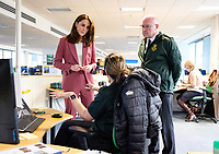 19/03/2020 - Picture released by Kensington Palace of Duchess of Cambridge accompanied by the Chief Executive of the London Ambulance Service, Garrett Emmerson (right) talking with staff during a visit to the London Ambulance Service 111 control room in Croydon on Thursday to meet ambulance staff and 111 call handlers who have been taking NHS 111 calls from the public, and thank them for the vital work they are doing. Photo Credit: ALPR/AdMedia
