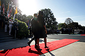 U.S. President Barack Obama and first Lady Michelle Obama walk out to welcome Pope Francis prior to his arrival ceremony at the White House on September 23, 2015 in Washington, DC. The Pope begins his first trip to the United States at the White House followed by a visit to St. Matthew's Cathedral, and will then hold a Mass on the grounds of the Basilica of the National Shrine of the Immaculate Conception. <br /> Credit: Alex Wong / Pool via CNP