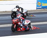 Jun 11, 2017; Englishtown , NJ, USA; NHRA pro stock motorcycle rider Hector Arana Sr (near) races alongside Steve Johnson during the Summernationals at Old Bridge Township Raceway Park. Mandatory Credit: Mark J. Rebilas-USA TODAY Sports
