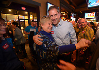 NWA Democrat-Gazette/ANDY SHUPE<br /> Denise Garner, Democratic candidate for State House District 84, gets a hug Tuesday, Nov. 6, 2018, from Greg Leding, Democratic candidate for State Senate District 4, as she enters the room during a watch party for the Washington County Democratic Party of Arkansas at Farrell's Lounge in Fayetteville.