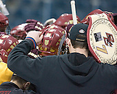 End of practice huddle - belt held by Tim McFeely.  The Boston College Eagles practiced on Wednesday, April 5, 2006, at the Bradley Center in Milwaukee, Wisconsin, in preparation for their 2006 Frozen Four Semi-Final game against the University of North Dakota.