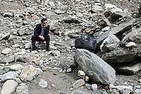A man sits on the Hailuogou glacier in western Sichuan Province, China. As a result of rising temperatures on the Tibetan Plateau, the Hailuogou glacier has retreated over 2 km during the 20th century alone. Since the Little Ice Age, studies have revealed that the total monsoonal glacier coverage in the southeast of the Tibetan Plateau has decreased by as much as 30 percent, causing alarm in scientific circles.