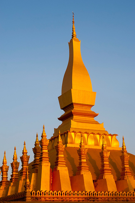 The That Luang Stupa in evening light in Vientiane, the capital and largest city of Laos.