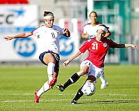 Charli Lloyd (11) battles for the ball against Norway's Lene Storl¯kken. USA 4,  Norway 0, Fredrikstad Stadium, July 2, 2008.