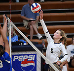 Althoff's Grace Strieker tips the ball over the net in the second game. Althoff defeated Columbia in two games in volleyball action on Thursday August 23, 2018.<br /> Tim Vizer/Special to STLhighschoolsports.com