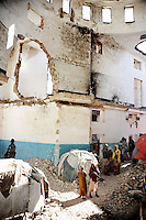 Mogadishu/Somalia 2012 - IDP´s living in the ruins of a building close to the former parliament which is also destroyed. More than 300.000 refugees are believed to live in the city´s ruins and camps.