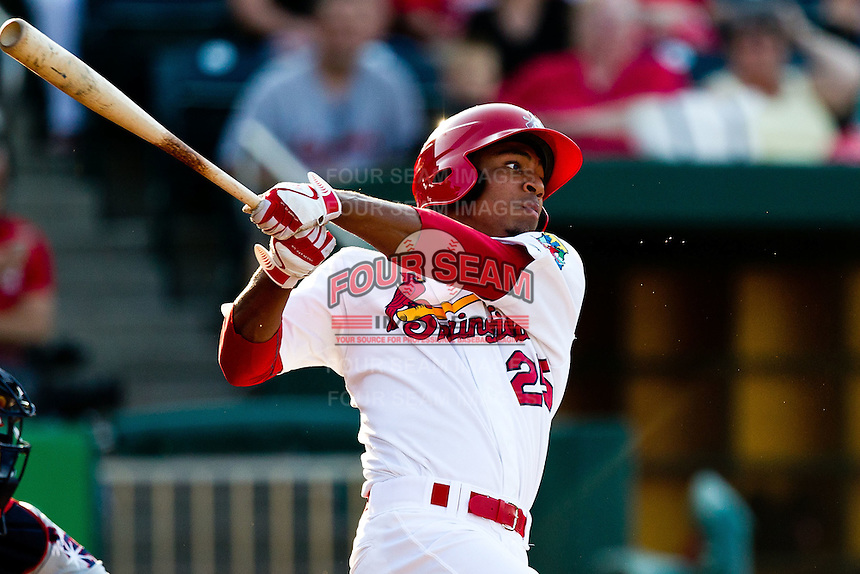 Oscar Taveras (25) of the Springfield Cardinals follows through his swing during a game against the Arkansas Travelers at Hammons Field on May 5, 2012 in Springfield, Missouri. (David Welker/Four Seam Images)