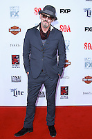 HOLLYWOOD, LOS ANGELES, CA, USA - SEPTEMBER 06: Tommy Flanagan arrives at the Los Angeles Premiere Of FX's 'Sons Of Anarchy' Season 7 held at the TCL Chinese Theatre on September 6, 2014 in Hollywood, Los Angeles, California, United States. (Photo by David Acosta/Celebrity Monitor)