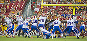 Buffalo Bills kicker Dan Carpenter (2) kicks a first quarter field goal during the pre-season game against the Washington Redskins at FedEx Field in Landover, Maryland on Friday, August 26, 2016. Pictured, from left to right: Redskins defensive end Preston Smith (94), Bills defensive tackle Corbin Bryant (97), Redskins unidentified,  Bills tackle Cyrus Kouandjio (71), Carpenter, Bills offensive guard Jamison Lalk (60), Bills offensive guard John Miller (76), Bills punter Colton Schmidt (6), Redskins defensive tackle Kendall Reyes (97), Bills long snapper Garrison Sanborn (65), unidentified Redskin, unidentified Redskin, Bills offensive guard Richie Incognito (64), unidentified Redskin, Bills offensive tackle Jordan Mills (79), and Bills guard Ryan Groy (72).  The Redskins won the game 21 - 16.<br /> Credit: Ron Sachs / CNP