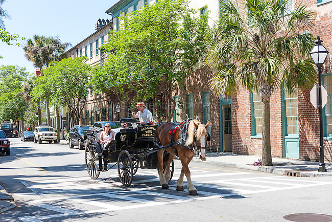 A couple takes a horse drawn carriage tour in historic Charleston, South Carolina.