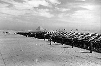 BNPS.co.uk (01202 558833)<br /> Pic: Pen&Sword/BNPS<br /> <br /> <br /> The 4th Hussars drawn up for inspection by Churchill, 3 December 1943.<br /> <br /> Previously unseen photos of Winston Churchill both in the theatre of war and at leisure afterwards have come to light in a new book.<br /> <br /> One snap shows him addressing troops of his 4th Hussars regiment in Cairo, while he is seen in another at the door of an aircraft with a trademark cigar in his mouth. <br /> <br /> There is also a candid image of the wartime leader painting at Lake Como in September 1945 where he convalesced after losing to Clement Attlee in the general election.<br /> <br /> The photos belonged to Lieutenant Colonel Anthony Barne, who was commanding officer of the 4th Hussars.<br /> <br /> The photos, and Lt Col Barne's war diaries, are published for the first time in a new book, Churchill's Colonel, which has been edited by his grandson Charles Barne.