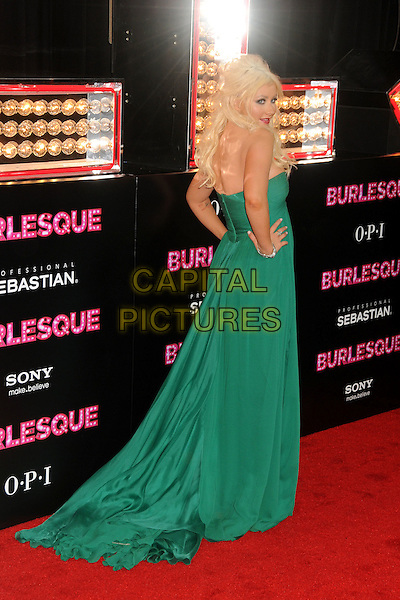 """CHRISTINA AGUILERA .""""Burlesque"""" Los Angeles Premiere held at Grauman's Chinese Theatre, Hollywood, California, USA, .15th November 2010..full length long maxi dress  green strapless train back over shoulder rear behind hands on hips .CAP/ADM/BP.©Byron Purvis/AdMedia/Capital Pictures."""