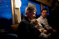 Senator Scott Brown (R-MA) speaks with Boston Herald reporter Joe Battenfeld on the campaign bus between stops in North Billerica and Wakefield, Massachusetts, USA, on Thurs., Nov. 2, 2012. Senator Scott Brown is seeking re-election to the Senate.  His opponent is Elizabeth Warren, a democrat.