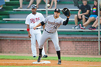 First baseman Rafael Valenzuela #14 of the Greeneville Astros stretches for a throw against the Elizabethton Twins at Joe O'Brien Field August 15, 2010, in Elizabethton, Tennessee.  Photo by Brian Westerholt / Four Seam Images