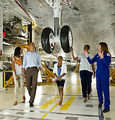 United States President Barack Obama, First Lady Michelle Obama, daughters Malia, left, Sasha, and Astronaut Janet Kavandi walk under the landing gear from beneath the nose of space shuttle Atlantis as they visit Kennedy Space Center in Cape Canaveral, Florida, Friday, April 29, 2011. .Mandatory Credit: Bill Ingalls / NASA via CNP