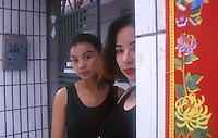 "Two women who admit to being second wives in Huang Beiling, also known as ""Second Wife Village"", in Shenzhen, China. The ""village"" is famous for the number of second wives  living there that cater either to wealthy local men or Hong Kong men that live just across the border and visit on weekends. The two ladies pictured have flats paid for by Hong Kong ""husbands""...PHOTO BY SINOPIX"