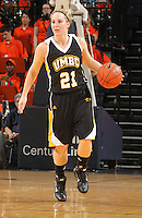 Dec. 18, 2010; Charlottesville, VA, USA; UMBC Retrievers guard Michele Brokans (21) handles the ball during the game against the UMBC Retrievers at the John Paul Jones Arena.  Mandatory Credit: Andrew Shurtleff-