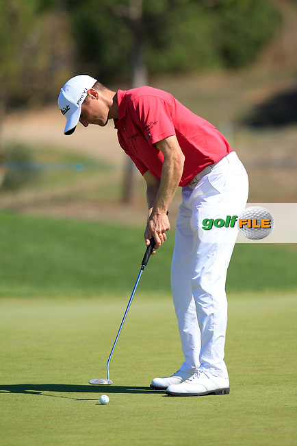 Michael Hoey (NIR) takes his putt on the 3rd green during Thursday's Round 1 of the 2013 Portugal Masters held at the Oceanico Victoria Golf Club. 10th October 2013.<br /> Picture: Eoin Clarke www.golffile.ie