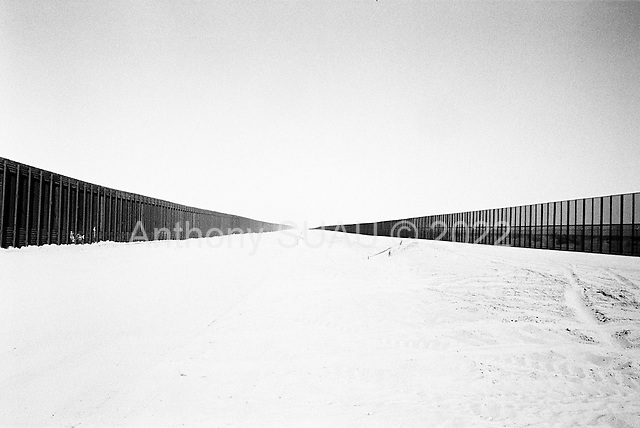 San Luis, Arizona<br /> May 1, 2008<br /> <br /> The new wall/fence on the US/Mexican border as seen from the US side of the border. This fence has slowed down illegal immigrant crossings substantially in the past 6 months. Many of the illegal crossings have pushing out toward the Tucson sector.
