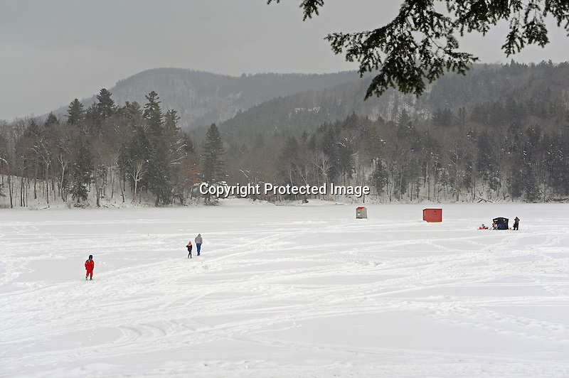Ice Fishing on a Snow Covered Lake in Vermont