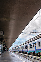 Fine Art Landscape photograph of the strong converging lines of the Termini train station in Rome, Italy.<br /> This photograph has very strong converging lines that lead to the focal point at the end of this scene. Even though the train is parked at the station the converging lines create a feeling of constant movement at the Termini train station.