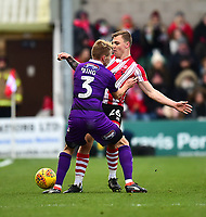 Lincoln City's Harry Anderson vies for possession with Grimsby Town's Sebastian Ring<br /> <br /> Photographer Andrew Vaughan/CameraSport<br /> <br /> The EFL Sky Bet League Two - Lincoln City v Grimsby Town - Saturday 19 January 2019 - Sincil Bank - Lincoln<br /> <br /> World Copyright © 2019 CameraSport. All rights reserved. 43 Linden Ave. Countesthorpe. Leicester. England. LE8 5PG - Tel: +44 (0) 116 277 4147 - admin@camerasport.com - www.camerasport.com