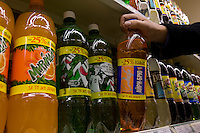 Moscow, Russia, 08/11/2007..A customer lifts a bottle of Irn-Bru from a row of Cyrillic labeled Pepsi brands in one of the Dvenadtsat Mesyatsev [Twelve Months] supermarket chain.