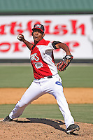 Jerry Gil #24 of the Carolina Mudcats pitching during a game against the Chattanooga Lookouts on on May 9, 2010 in Zebulon, NC.