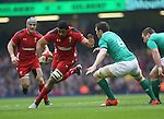Wales number 8 Taulupe Faletau takes on Irish flanker Peter O'Mahony.<br /> RBS 6 Nations<br /> Wales v Ireland<br /> Millennium Stadium<br /> 14.03.15<br /> &copy;Steve Pope - SPORTINGWALES