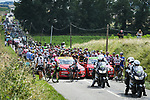 The peloton has to stop as a farmers protest has blocked the roads and riders suffer as police use pepper spray to clear them during Stage 15 of the 2018 Tour de France running 218km from Carcassonne to Bagneres-de-Luchon, France. 24th July 2018. <br /> Picture: ASO/Pauline Ballet | Cyclefile<br /> All photos usage must carry mandatory copyright credit (© Cyclefile | ASO/Pauline Ballet)