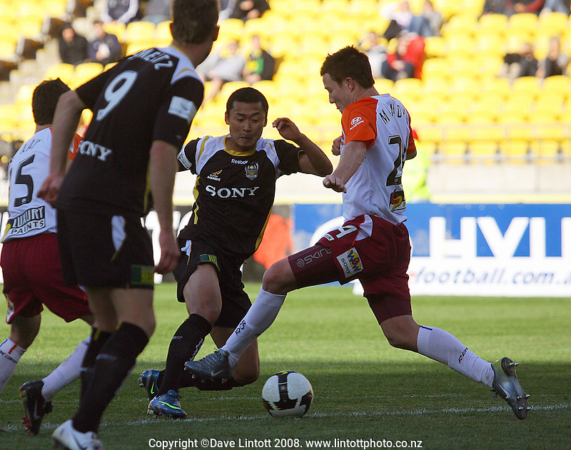 Leilei Gao is fouled by Matthew Mundy at the edge of the box during the A-League football match between the Wellington Phoenix and Queensland Roar at Westpac Stadium, Wellington. Sunday, 26 October 2008. Photo: Dave Lintott / lintottphoto.co.nz